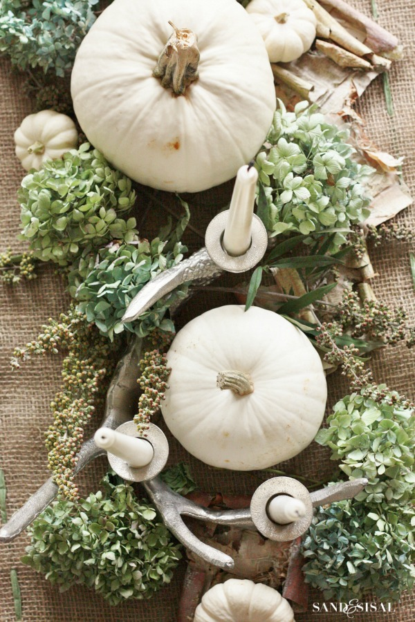 We're still loving white pumpkins and natural elements. Rustic chic at it's best. Found on  Sand and Sisal