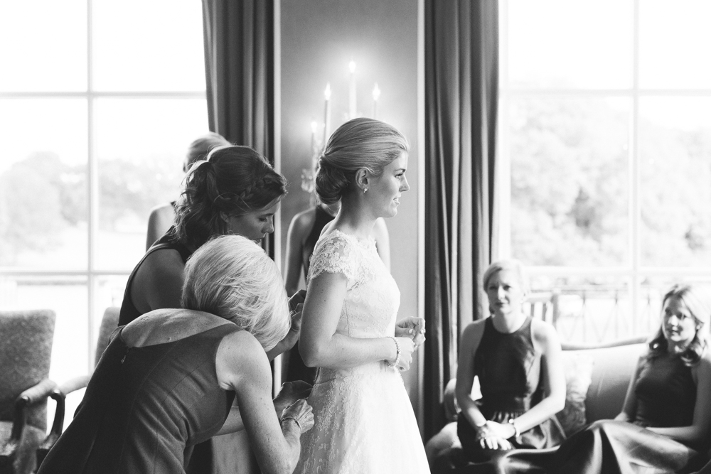 bride_putting_on_gown