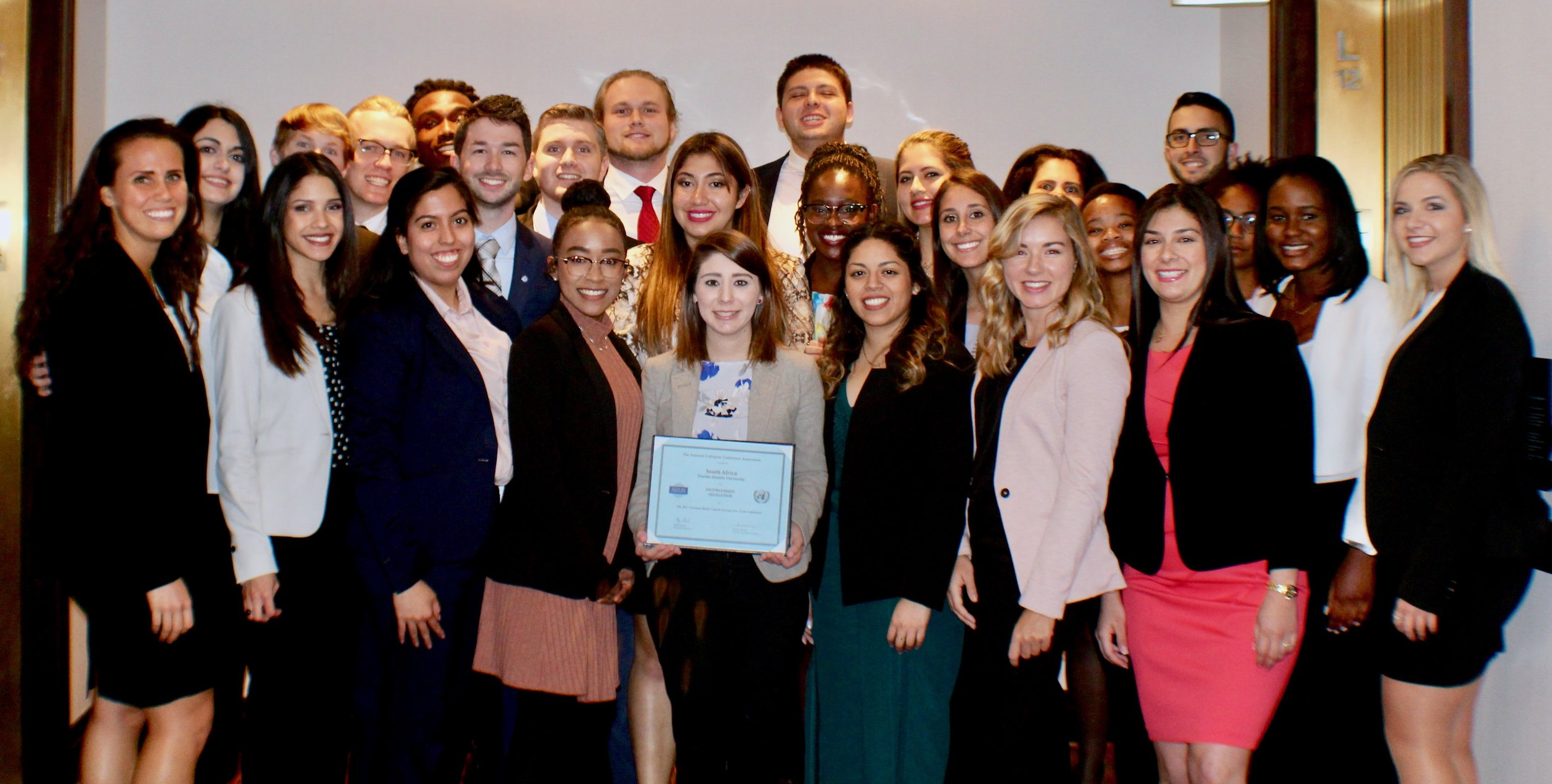 Student delegation in New York with their award