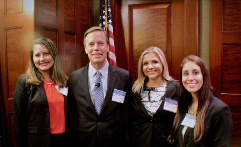 Maria, Jessica and Alexa with U.S. Ambassador Nicholas Burns at the Forum.