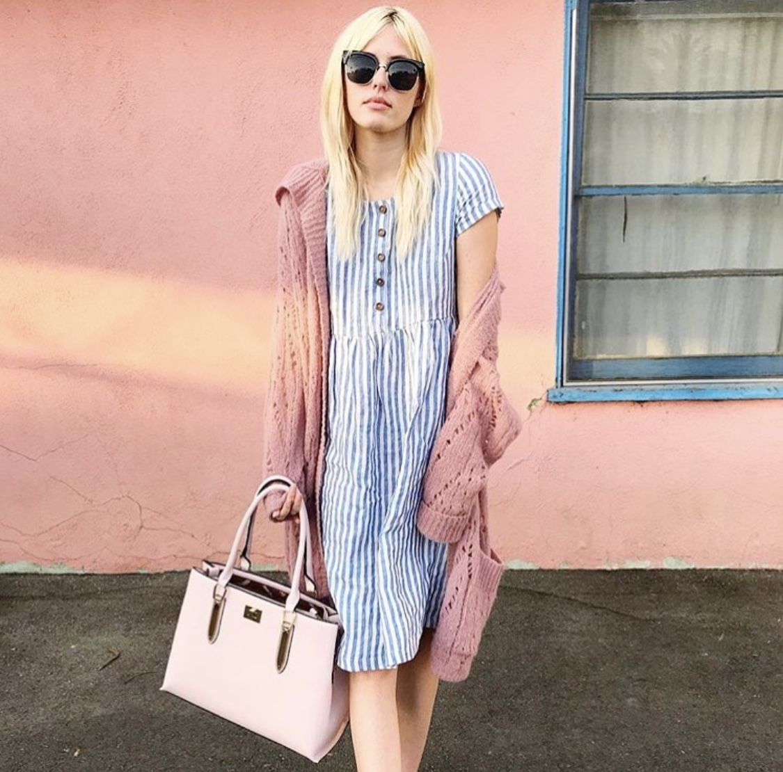 Bags & Cardigans. - Have a patterned dress but not sure how to style it up for a day out? Add a contrasting color cardigan or jacket that has similar color tones to a handbag.It looks chic, it's a classic style and you'll feel like the all powerful boss that you are.Image of @carolineelizabethDress: Model No.11 in Blue stripe LinenCardigan and bag: Models own.
