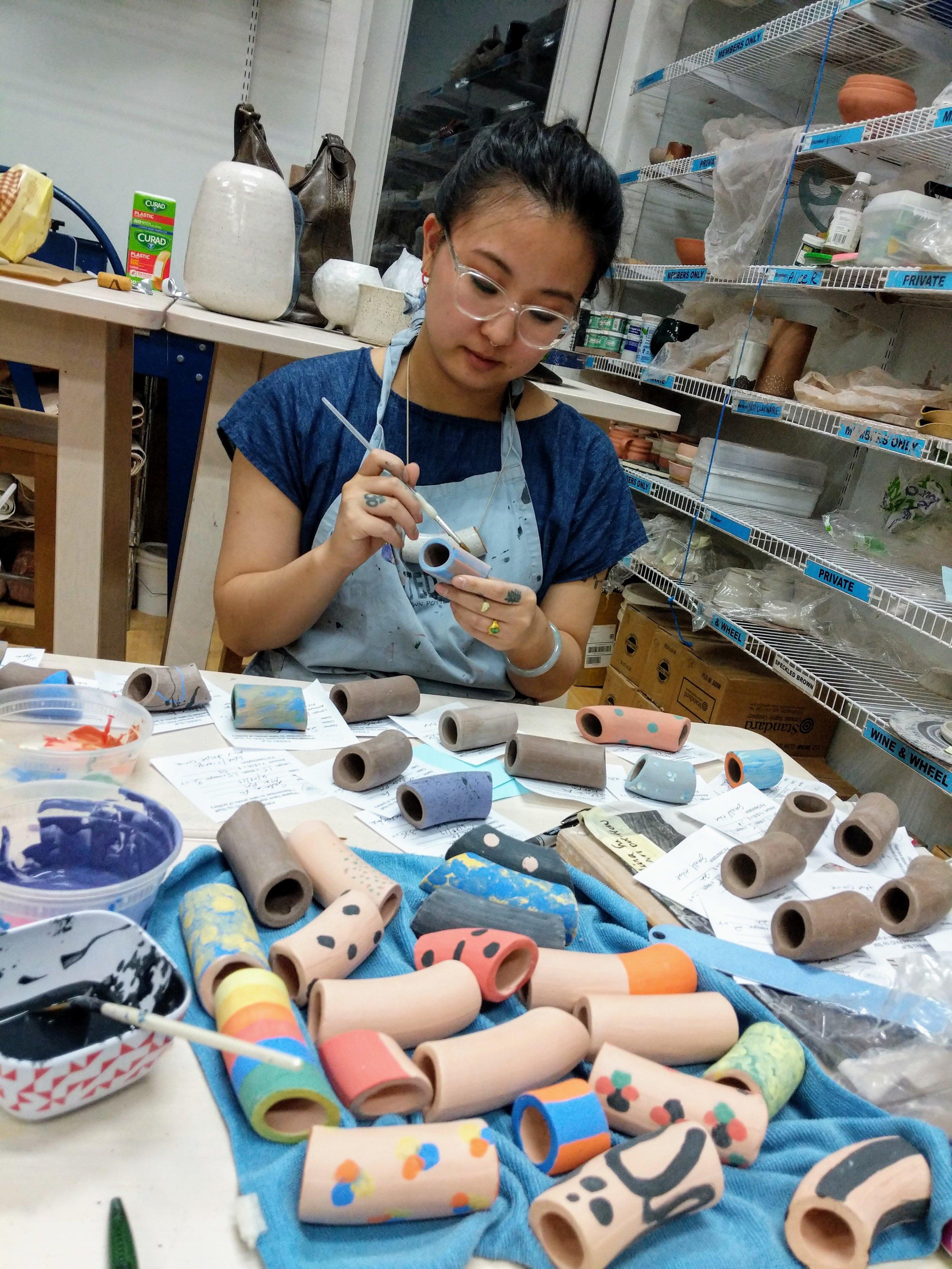 Salina working on Pottery.