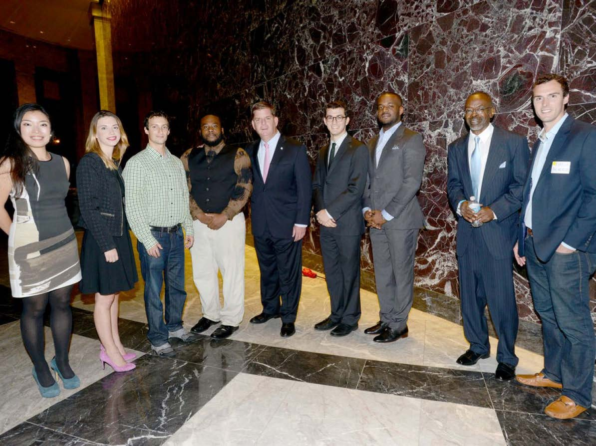 Aeron (left) with Boston Mayor Marty Walsh and other OneIn3 award winners. (Photo by the Mayor's Office/Don Harney)