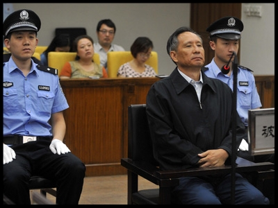ZHANG SHUGUANG SITS DURING HIS 2013 TRIAL FOR CORRUPTION. ZHANG, THE FORMER DEPUTY CHIEF ENGINEER OF CHINA'S MINISTRY OF RAILWAYS AND RIGHT-HAND MAN OF MINISTRY HEAD LIU ZHIJUN, ADMITTED TAKING BRIBES, BRIBES THE PROSECUTION PUT AT 47.55 MILLION YUAN ($7.7 MILLION). ZHANG BOUGHT A CALIFORNIA MANSION IN 2002 DESPITE BEING ON A MONTHLY SALARY OF 2,200 YUAN ($265 AT THE EXCHANGE RATE FOR THE TIME).