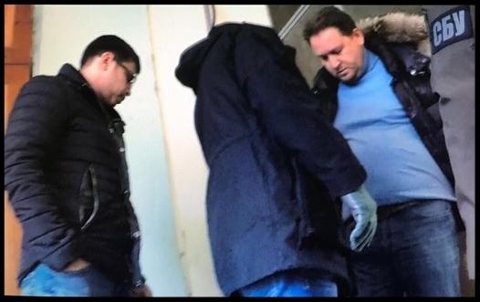 Security Service of Ukraine officers arrest Vladislav Khalupsky, U.S trader with Ukrainian roots, suspected of financial fraud and involvement in laundering $30 million on U.S international arrest warrant in Odesa in February.