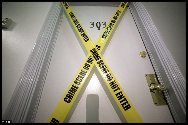 Crime scene: Yellow tape covers the door of the apartment where fugitive crime boss Bulger and his longtime companion Greig were arrested Wednesday in Santa Monica, California, after 16 years on the run.