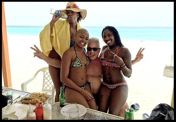 Calvin Ayre poses with women in Antigua in an image posted to his Facebook page