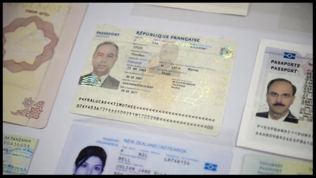 Fake passports are displayed at the immigration bureau in Bangkok.