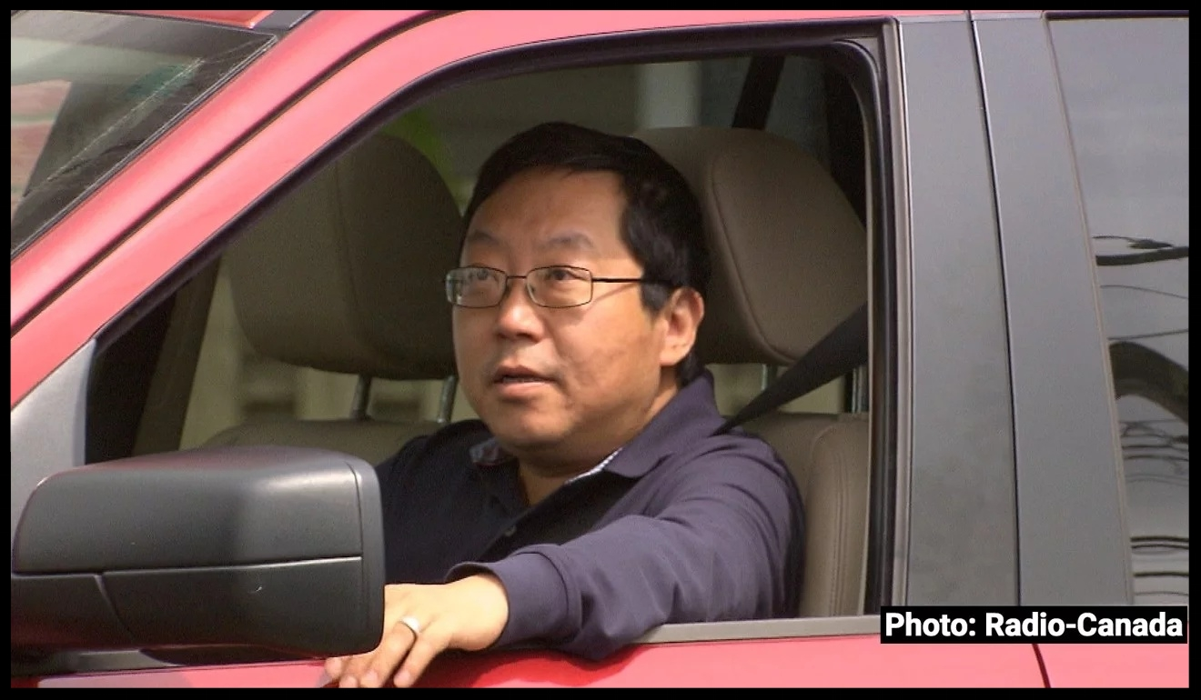 """Former unlicensed immigration consultant Xun """"Sunny"""" Wang is seen in a photo taken by Radio-Canada's investigative programme 'Enquête' as he was leaving his home in Richmond, British Columbia. Wang, who was freed from prison in late 2017, refused to answer Radio-Canada's questions; nor did he respond to a written request for a response left by the 'South China Morning Post' at his home. Photo: Harold Dupuis/Radio-Canada"""