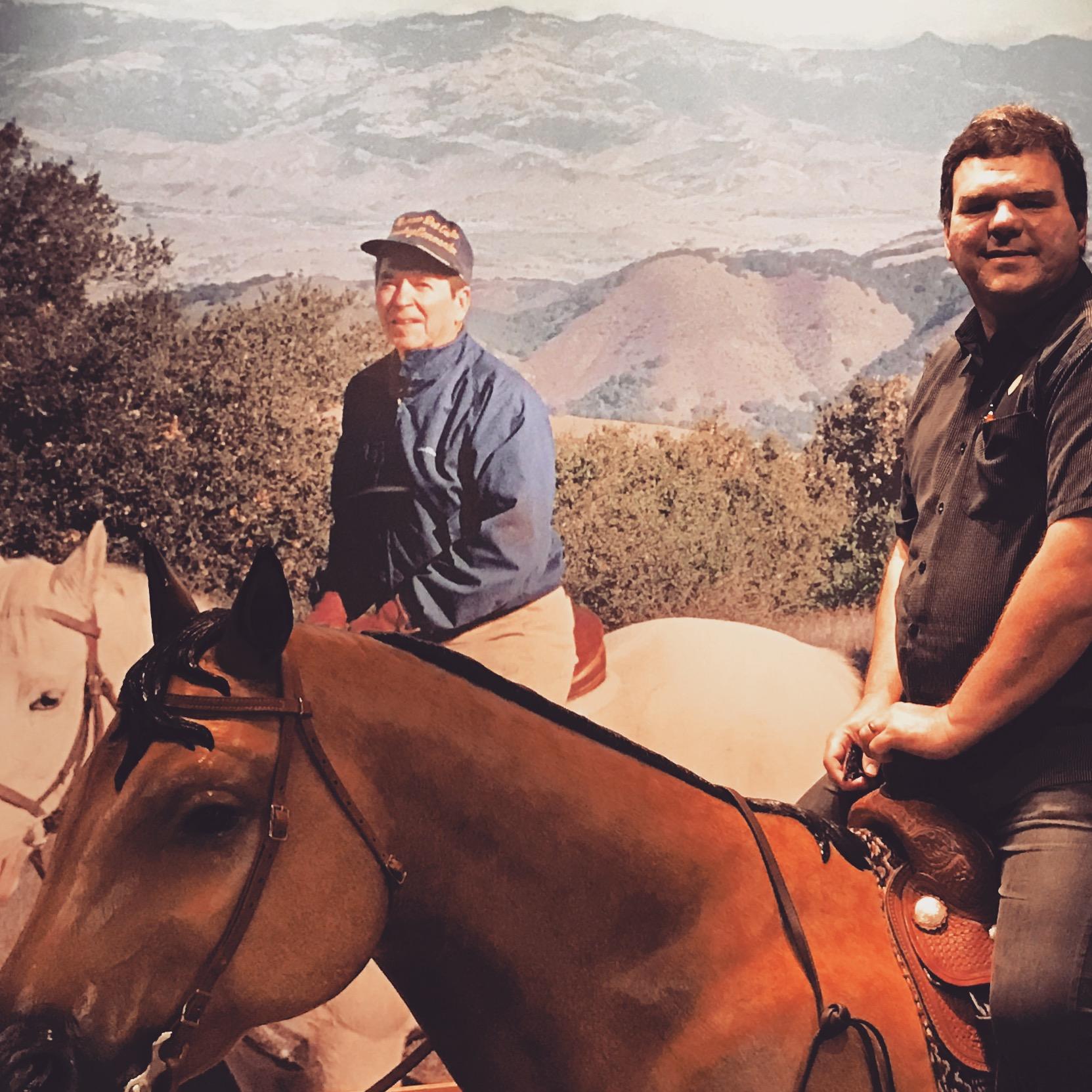 kyle riding with reagan.JPG