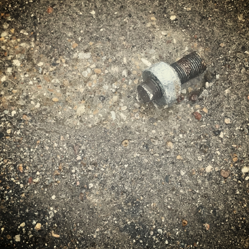 I was walking across the street toward downtown. In the middle of the road was a lump. As I got closer I could see it was a bolt. Then I realized it was not a bolt, but part of a blot and a nut. The broken end was jagged and gave me a shudder. It was a wheel lug stud. This is the part that sticks out of the wheel hub. It sticks through tire rim. Then a lug nut is screwed on and keeps the tire connected to the car.   I thought about the person driving around without this lug in place. I wondered if they knew or if they were oblivious. I wondered if it mattered. There are other several patterns for cars and trucks, but 4-6 seems to be standard. Missing one is missing alot. I worried about this missing lug enough to check my own wheels. It would be silly to be driving around without one on my own cars. All of mine were present and accounted for.  How quickly does a person need to respond to a missing safety nut? Can I just live with three? How about two? Will one work in a pinch? Can I use duct tape? How long would you let the situation degrade until you responded and fixed the underlying problem?  Lots of people in life are living on the ragged edge. They are abandoning the safety measures that protect themselves. We ignore the advice of our doctors. We don't get enough rest. We don't eat the right foods. We neglect our inner lives, hurrying before praying. All the while we hope that none of it catches up with us and the wheels don't fall off.   I picked up the bolt and carried it around a while. I eventually threw it in the trash. I'm trying not to forget its lessons.
