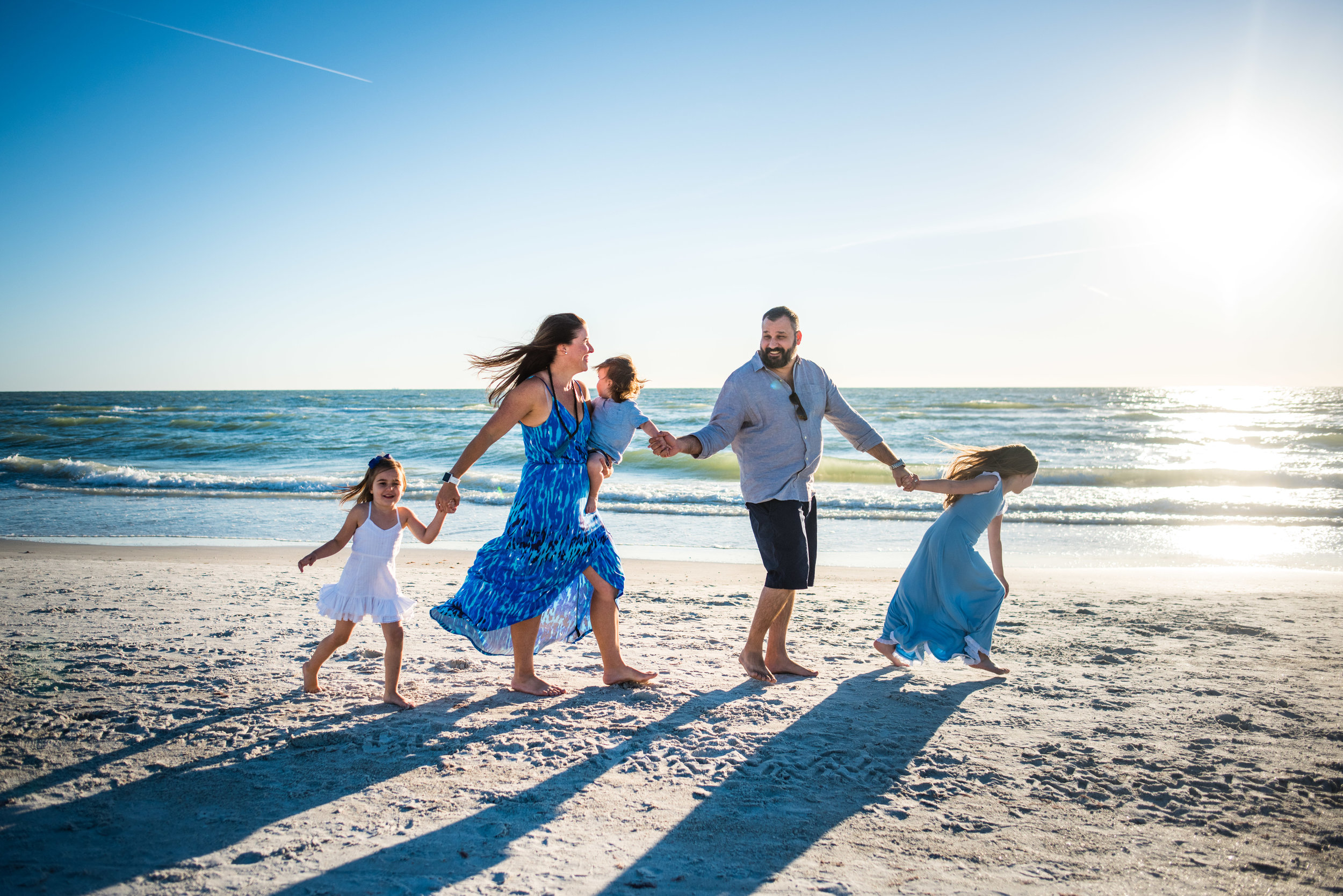 family walking on beach vacation