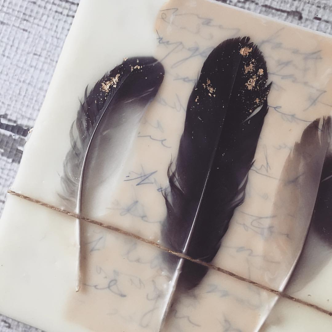 Embedded feathers and vintage papers in wax