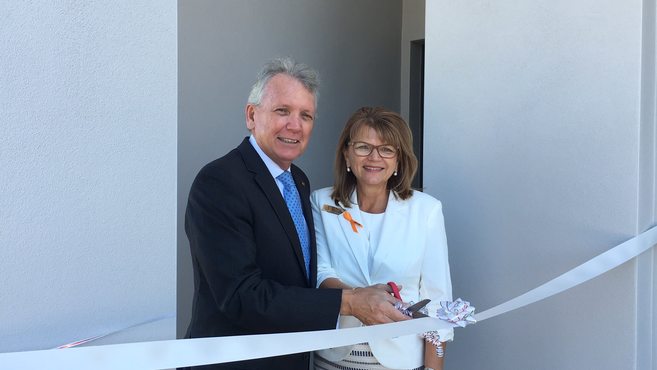 Mark McArdle and Zonta President Kelly Callaghan cutting the ribbon the new DV house in Caloundra