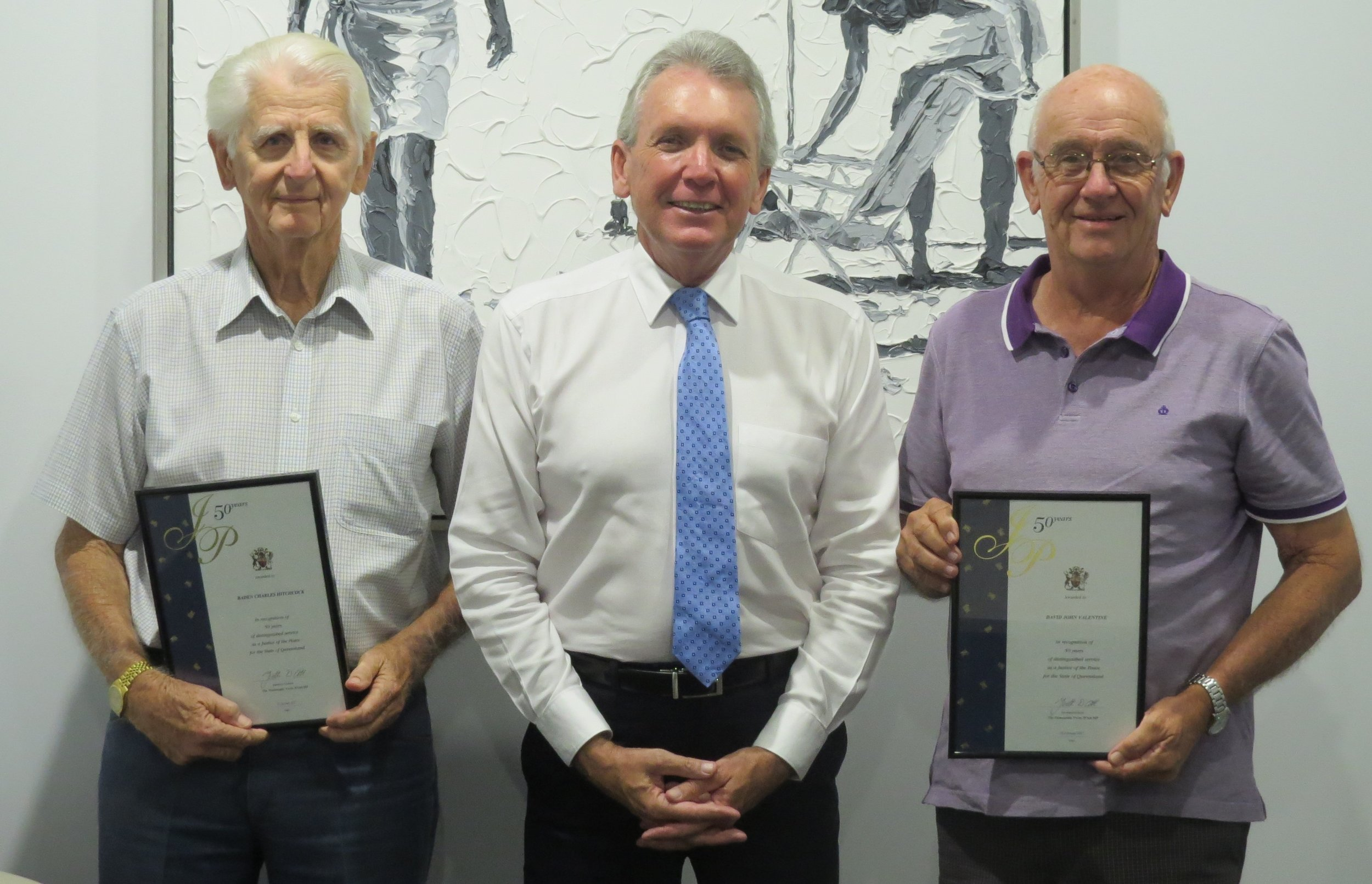 Baden Hitchcock and David Valentine are presented with their 50-year JP Long Service Awards from Mark McArdle MP