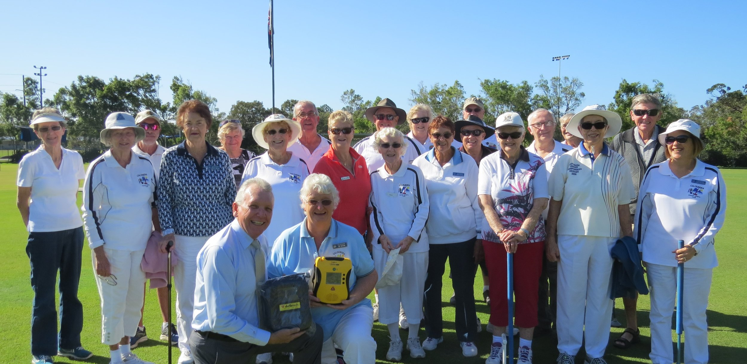 Mark McArdle with Caloundra Mallet Sporting Club President Sue Bertram (front) and members of the Club
