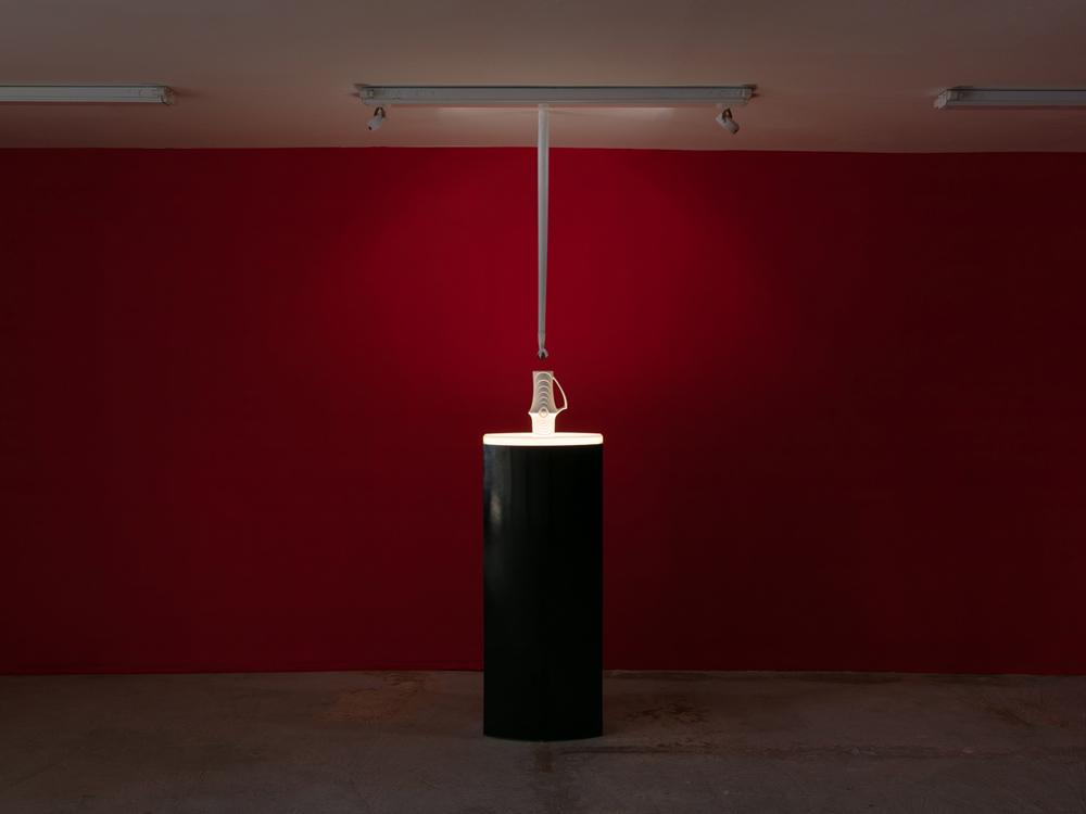 Rose Kallal   The Drop , 2016  Lighted pedestal, proclaim KPM Royal vase, wood, cast iron, glass  92 x 40 x 16 inches