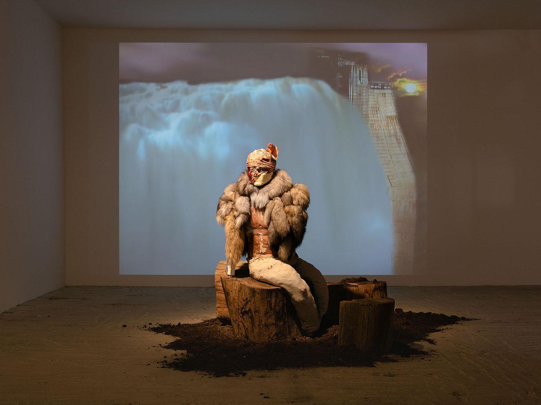 Yves Scherer    Aztec Eagle , 2017  Boxing dummy, fur, plaster, fabric, sweatpants, wood, paint, soil, metal, expanding foam  52 x 29 x 26 inches