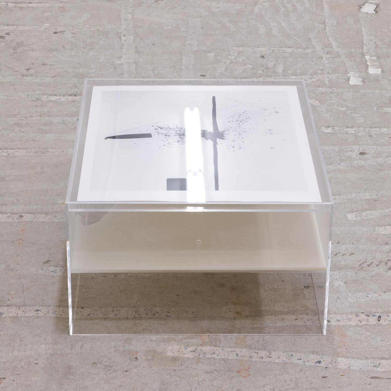 Harold Edgerton   Bullet Through Glass , 1962  Gelatin silver print  20 x 16 inches  Artist's Proof    Jo-ey Tang   Container For Bullet Through Glass , 2017  Plexiglass box, macadamia milk  17 x 21 x 10 inches