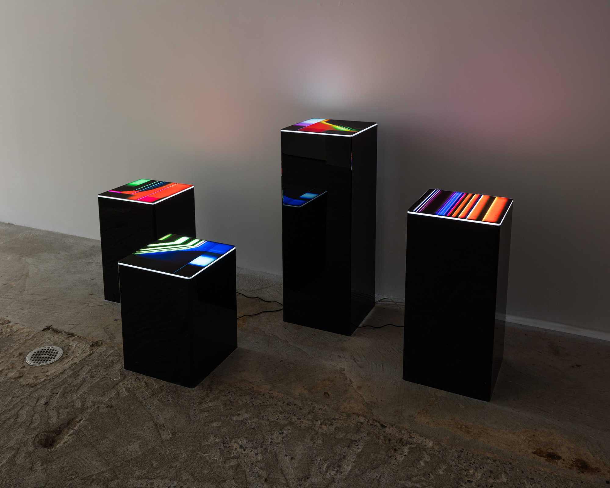 Rose Kallal   Tesseract , 2019  Four plexiglass pedestals with lighted Duratran prints  Dimensions variable