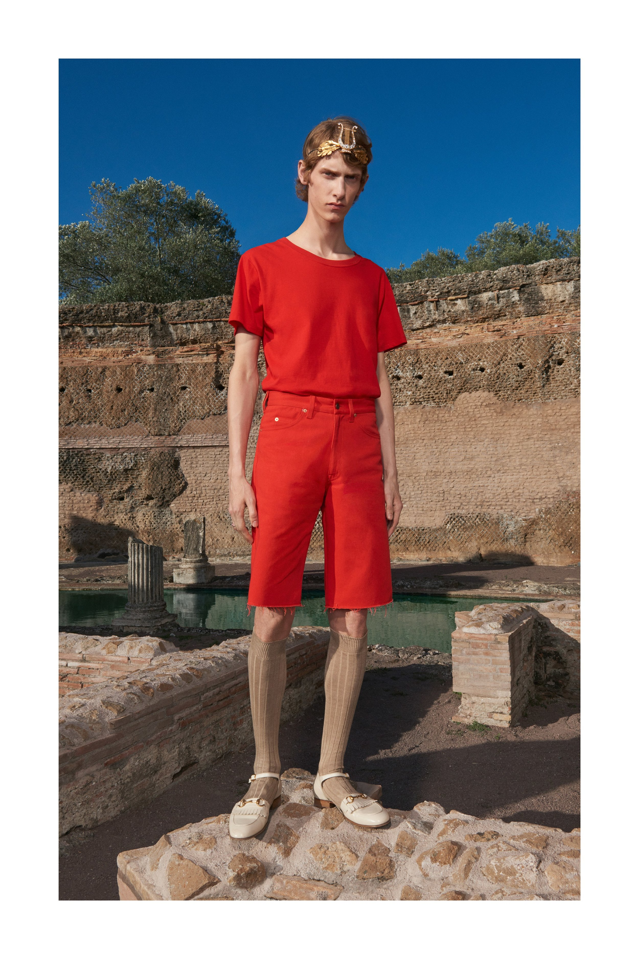 """Collections like this are supposed to make you  feel  something. I can't see a man on the street wearing those loafers/sandals/platforms, but they made me look a few times - that's fashion's job. But when I look at this monochromatic orange look, the only vibes I get are """"Its my first day of 3rd grade"""" vibes."""