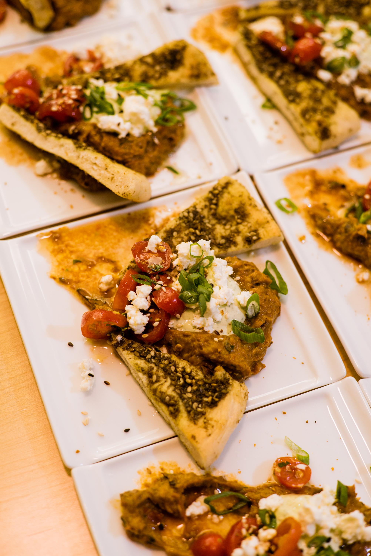 Swank Specialty Produce Eggplant and Tomato Spread  Zataar flatbread, mint strained yogurt, toasted sesame, fruity italian olive oil