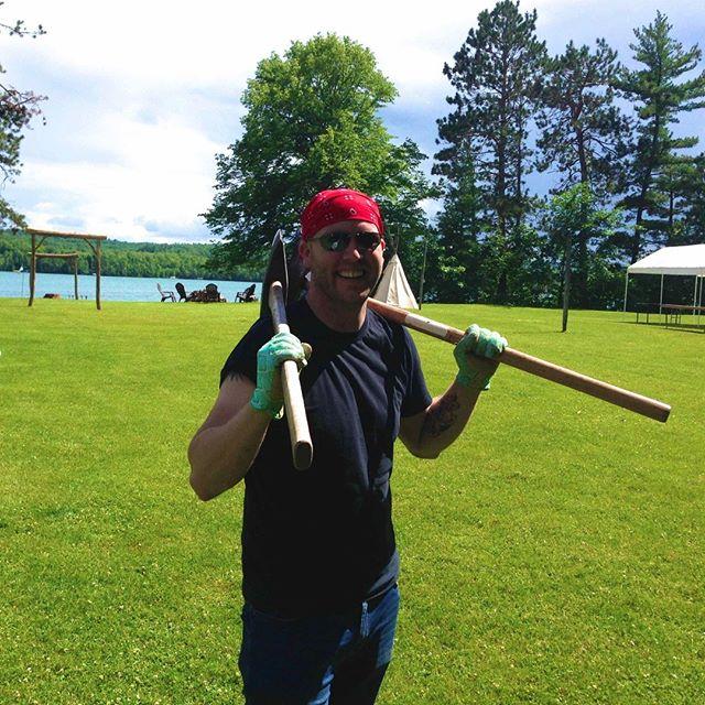 #jennaandjoewedding groom Joe Grengs prepares to split wood for the #sugarcrest #lakewedding fire