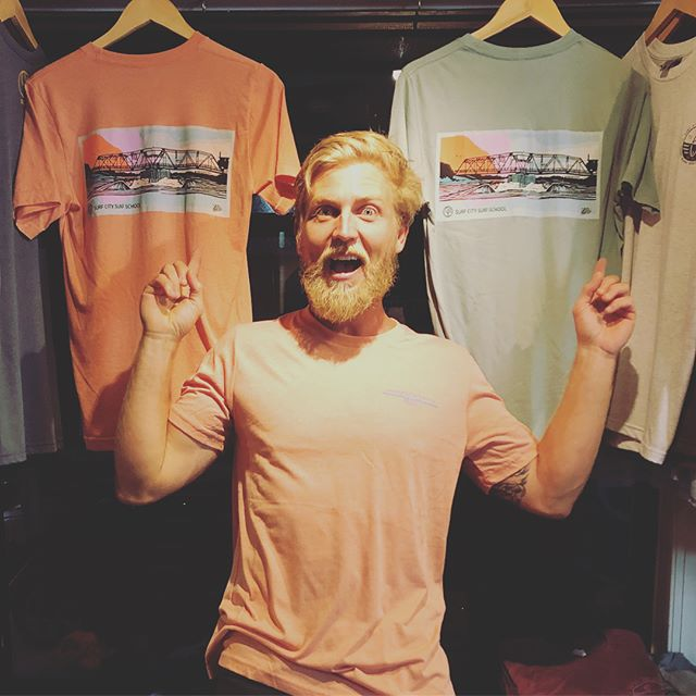 Collaboration station!! Local artist @daves__not__home + #surfcitysurfschool + @csipromo + our iconic swing bridge = a sweet tee. Come have a feel! #freshgear #surfcity #swingbridge #nc #localartist #topsailisland #locallymade #nc #yew
