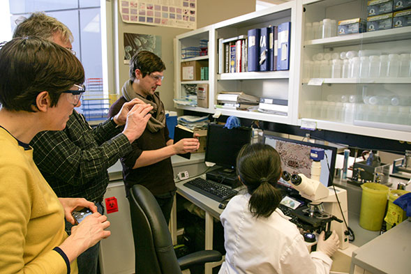 Artists Becky Shaw, Peter von Tiesenhausen and Steve Gurysh during a visit at the City's Micro-Biology laboratory