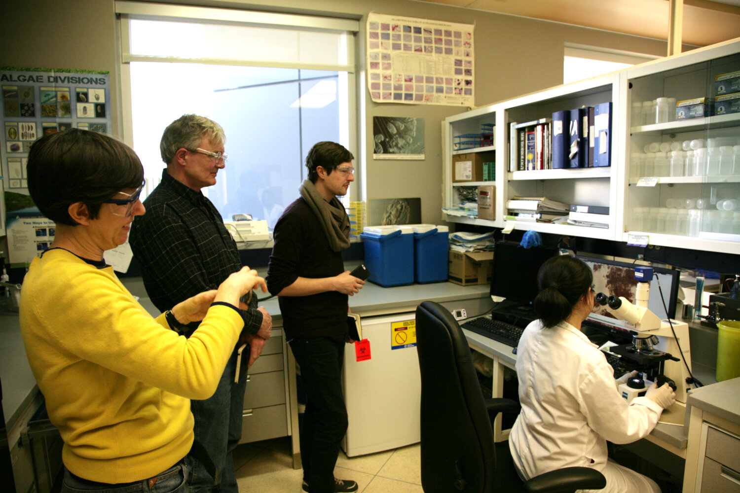 Artists Becky Shaw, Peter von Tiesenhausen, and Steve Gurysh during a visit at the City's Micro-Biology laboratory.