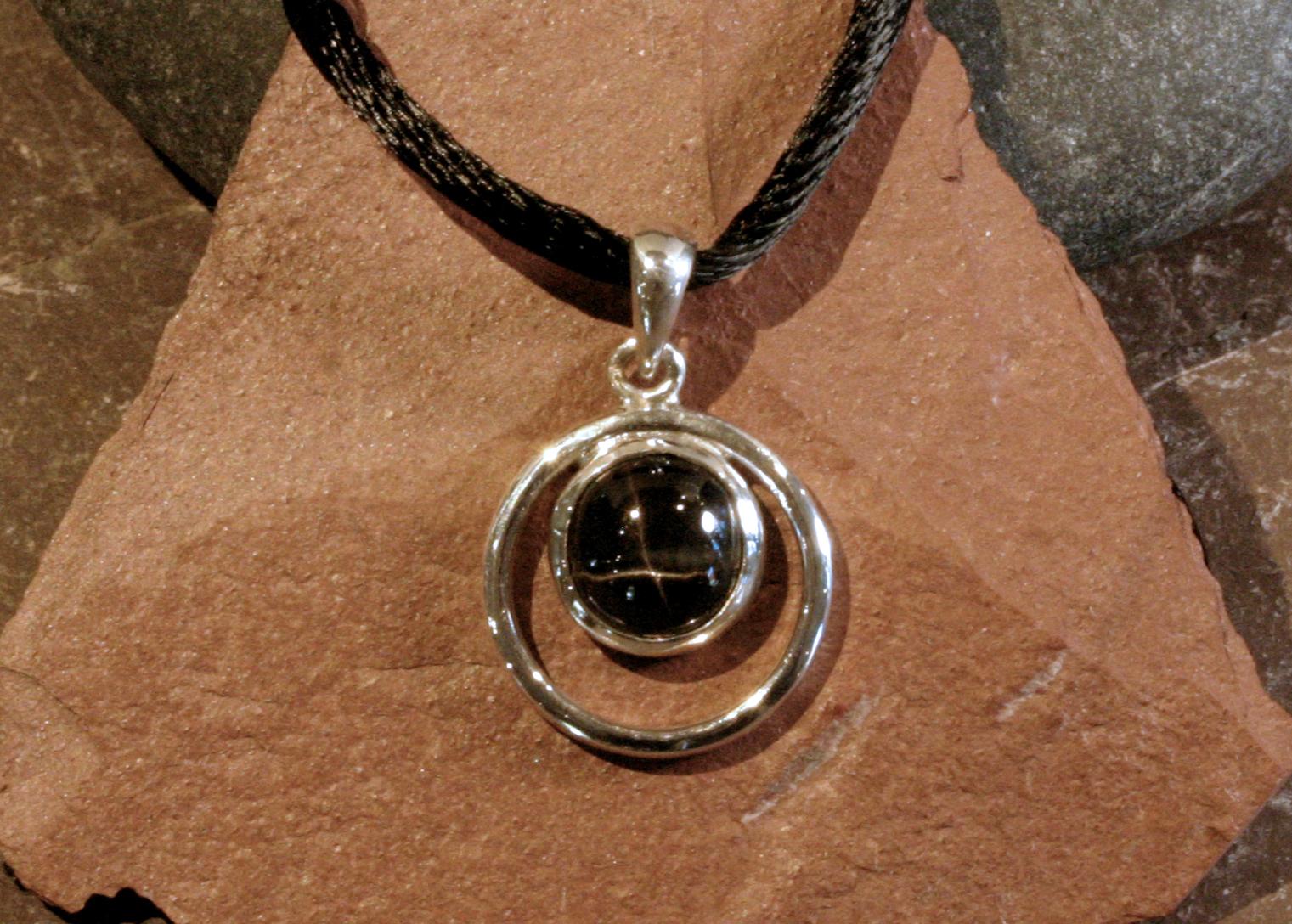 Sterling silver black star sapphire circle pendant