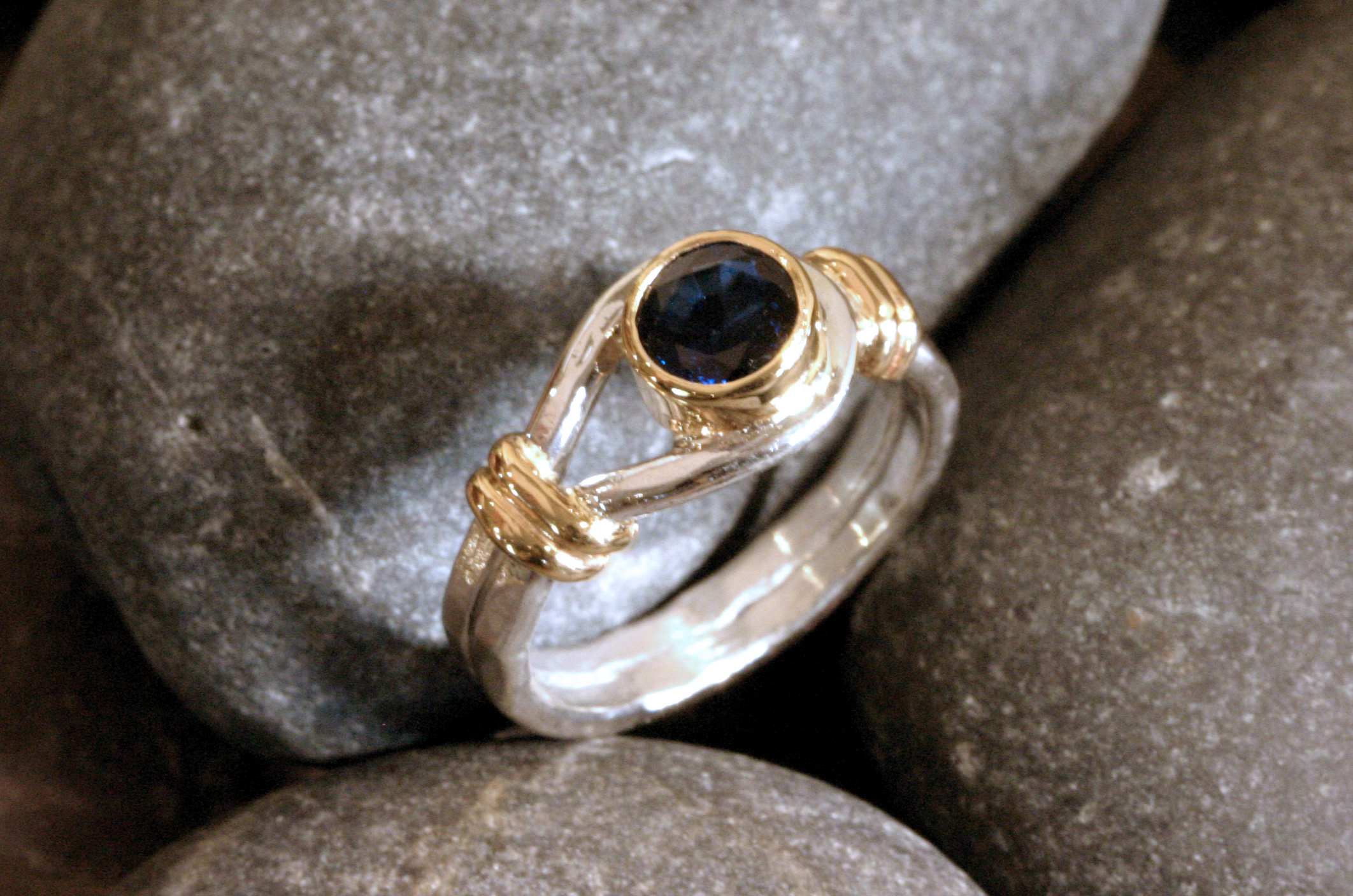 Sterling silver & 14K gold button ring with a bezel set blue sapphire for the button