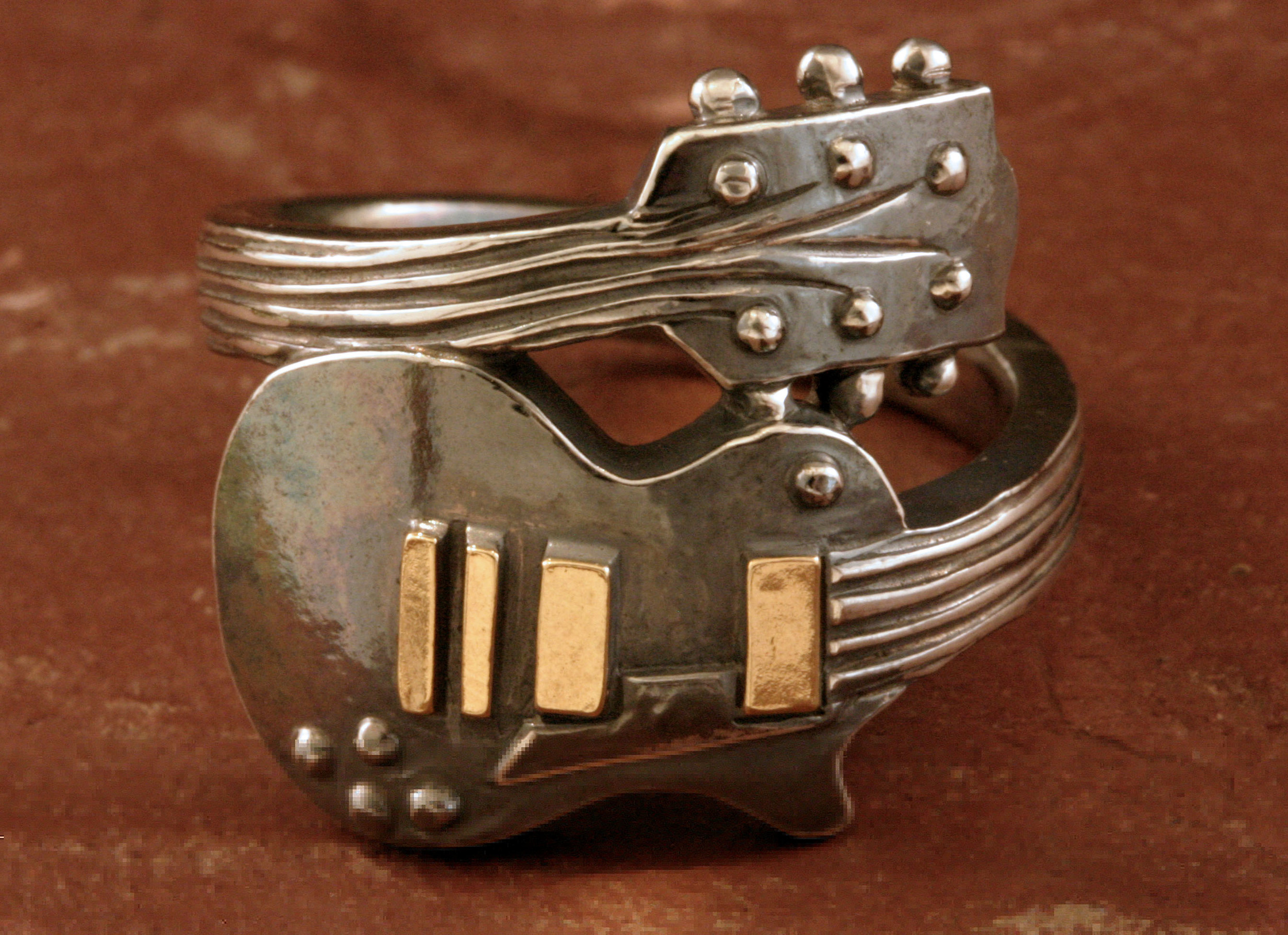 A guitar ring in oxidized sterling silver & 14K gold