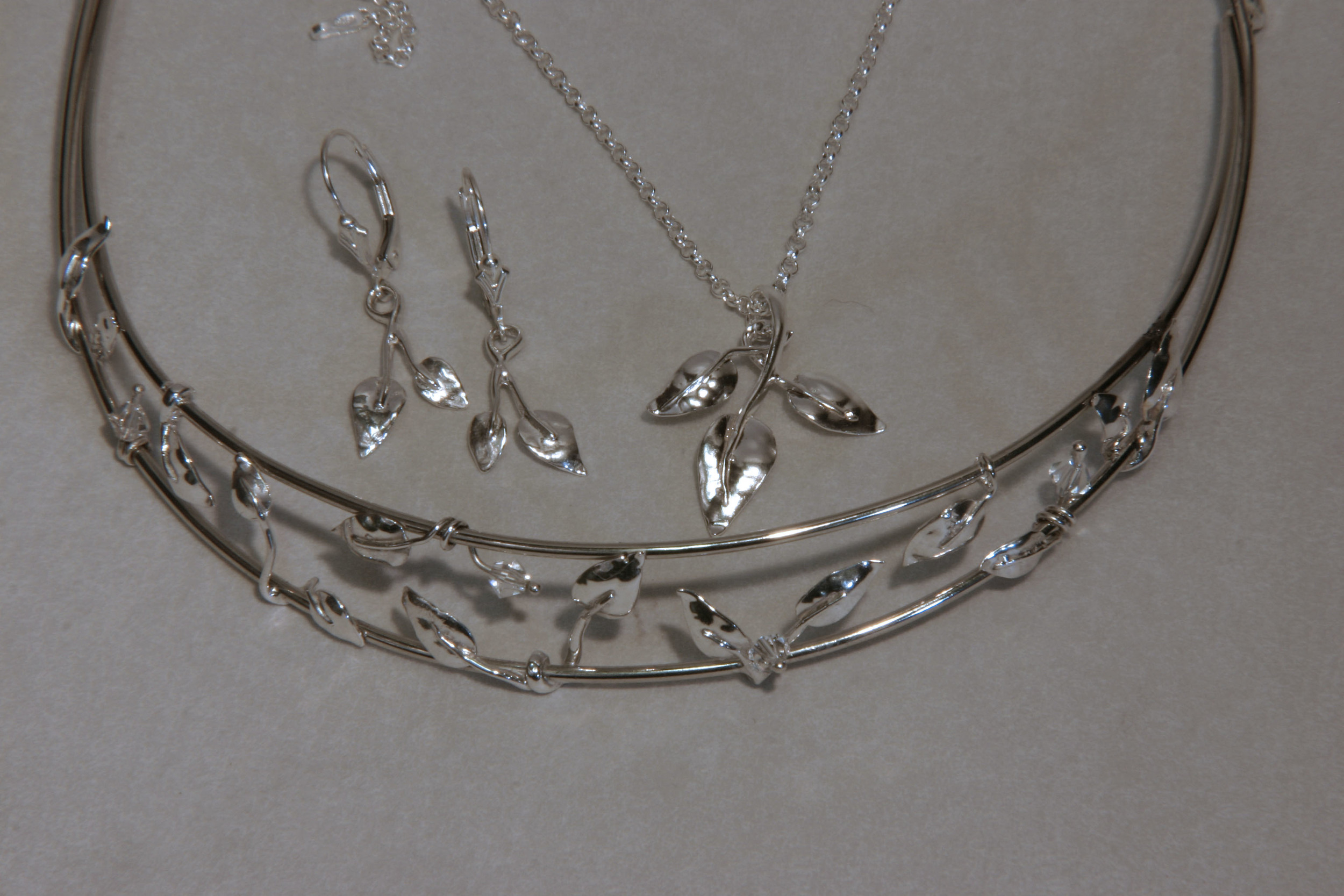 Sterling silver leaf motif bridal set of  a tiara, earrings, & pendant.