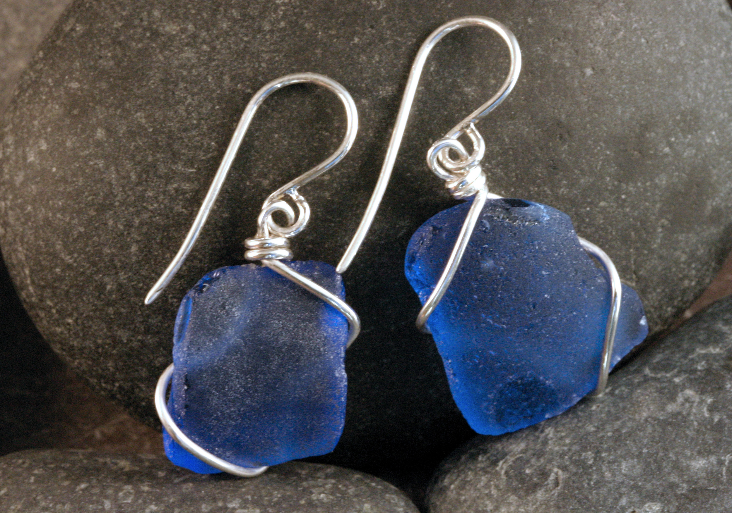 Blue seaglass wire wrapped into sterling silver earrings.