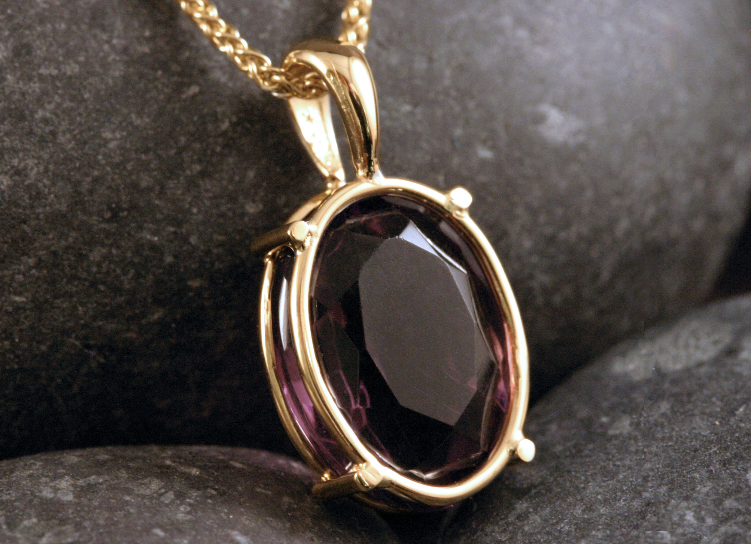 A 14K gold & amethyst pendant.