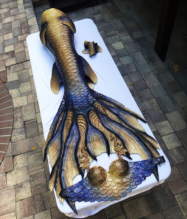 The @chesapeakemermaid has evolved! 3 years ago we made this lovely mermaid her first set of scales and recently we had the honor of upgrading her to a fresh, shiny new set! Her signature design inspired by the sturgeon was kept but we jazzed it up with some new color shifting blues/purple and golds. We are so happy to see our customers out there spreading the message of conservation through mermaiding. If you haven't, give her page a follow and check out her new book The Last Bivalvian, a fun and educational story about the biosphere that is the Chesapeake Bay 🌎 ❤️ • #mermaid #mermaids #mermaidtail #mernation #siliconetail #siliconemermaidtail #tailmaker #professionalmermaid #chesapeakebay #thechesapeakemermaid #conservation