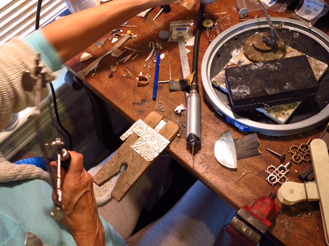 The jeweler at her bench