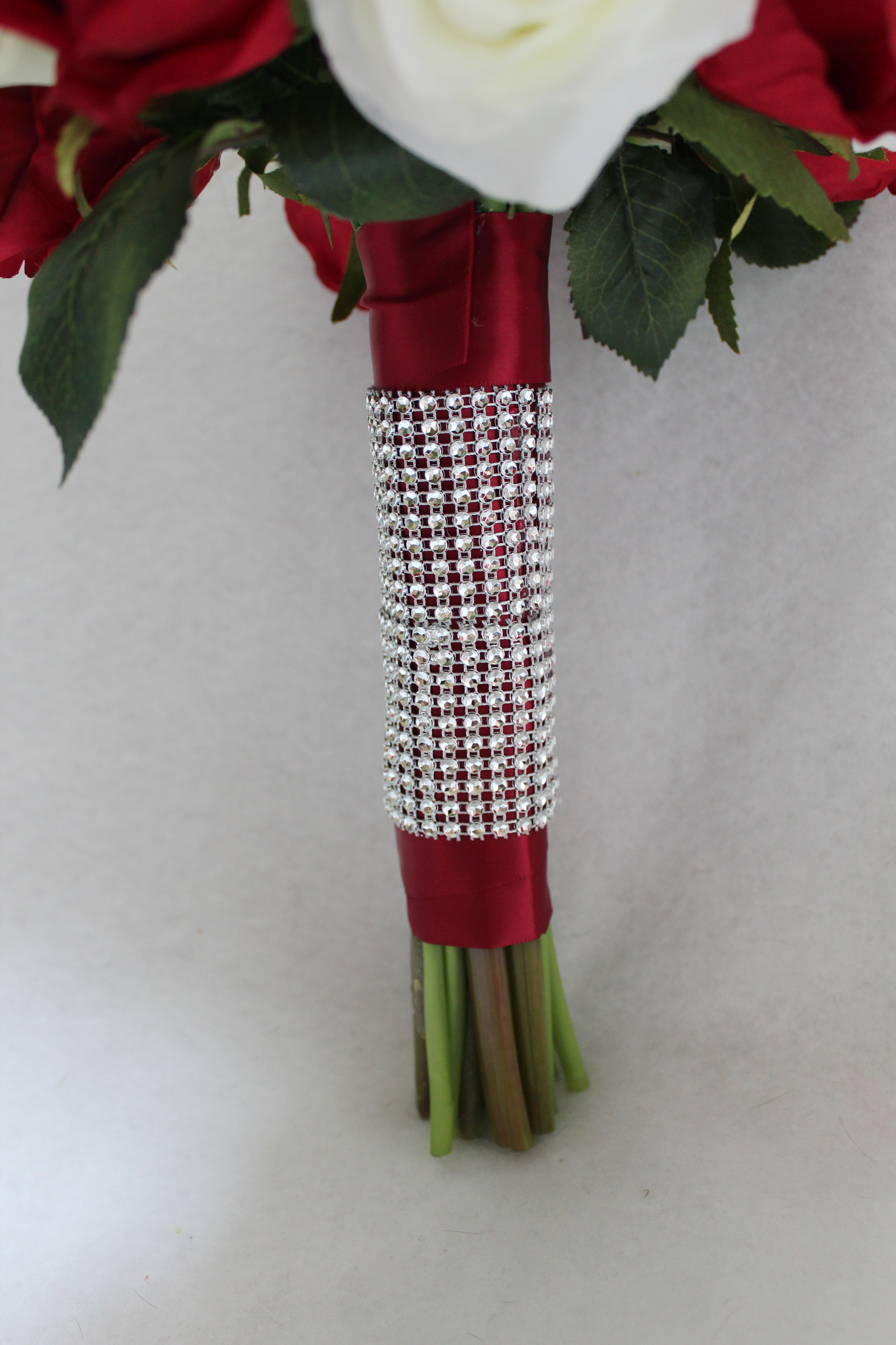 minneapolis-silk-florist-red-and-white-flowers-with-rhinestones-bridal-bouquet.jpg