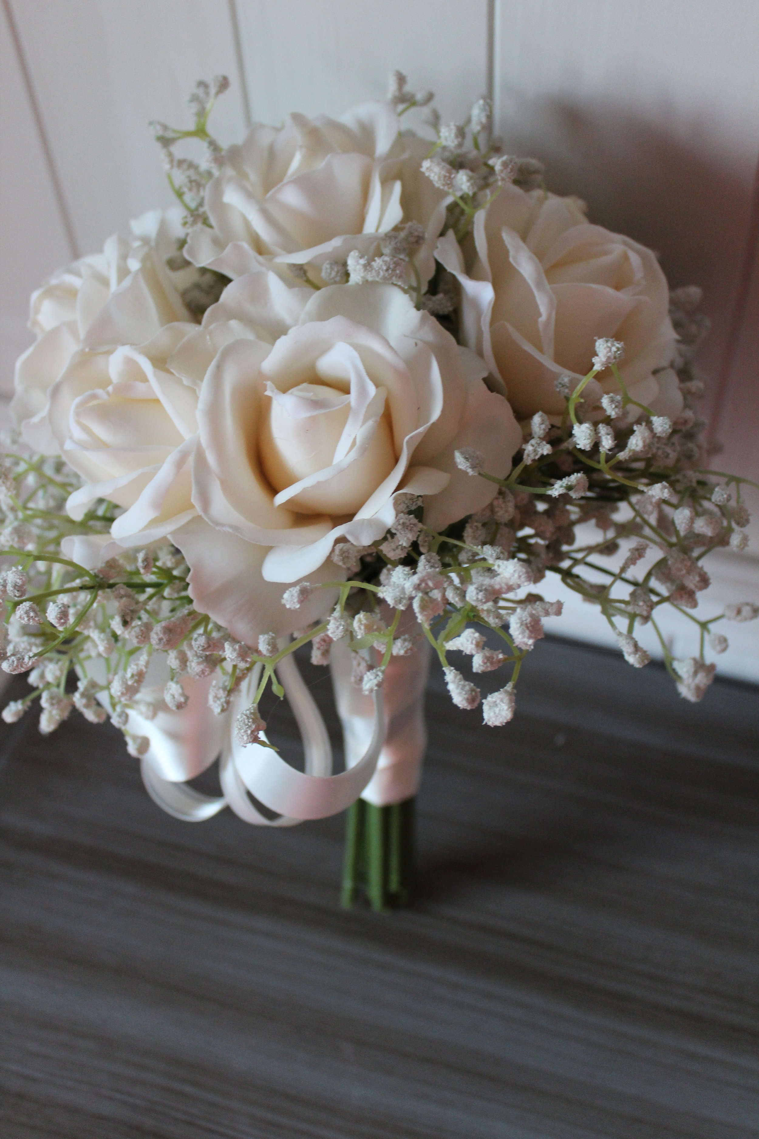Bridal bouquet recreated in silk flowers.