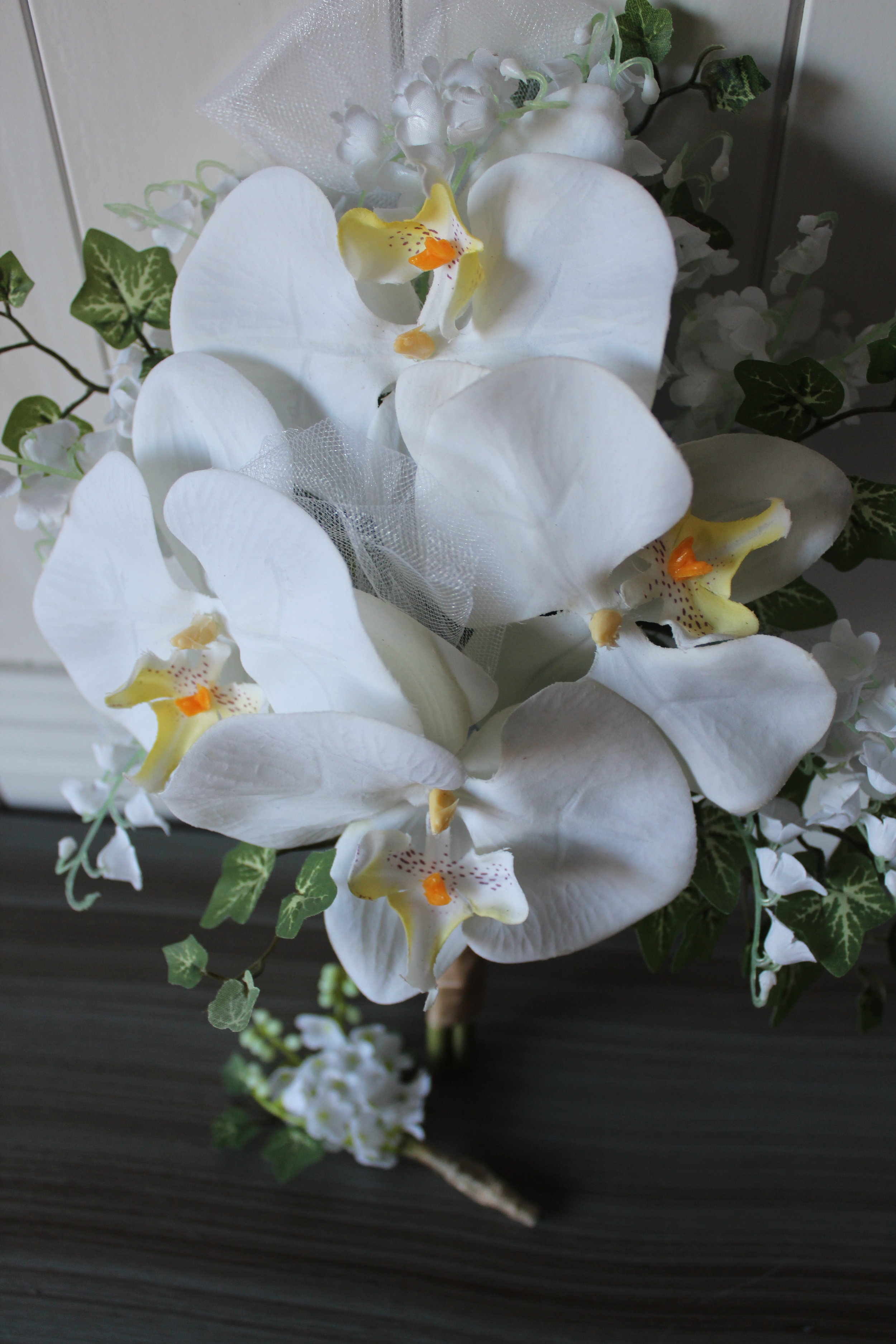 Phalaenopsis Orchids, Lily of the Valley, and Ivy