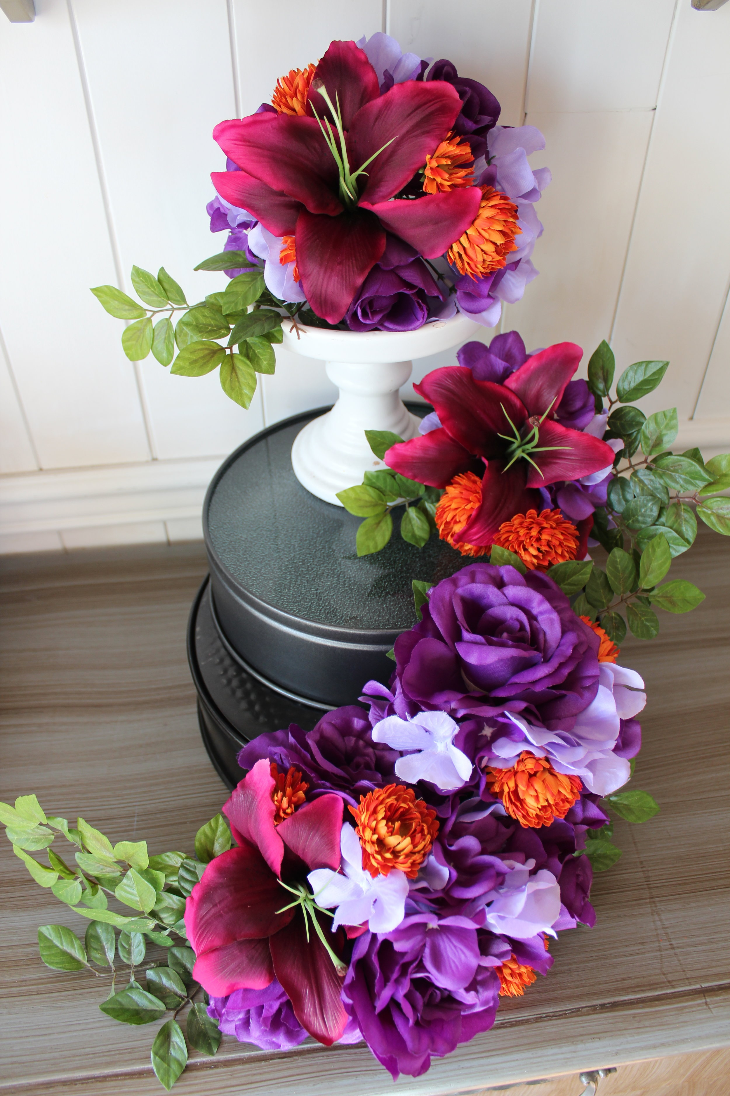 Not exactly a Pinterest-worthy setup, but shows off the beautiful cascade of flowers that will be added to their wedding cake.