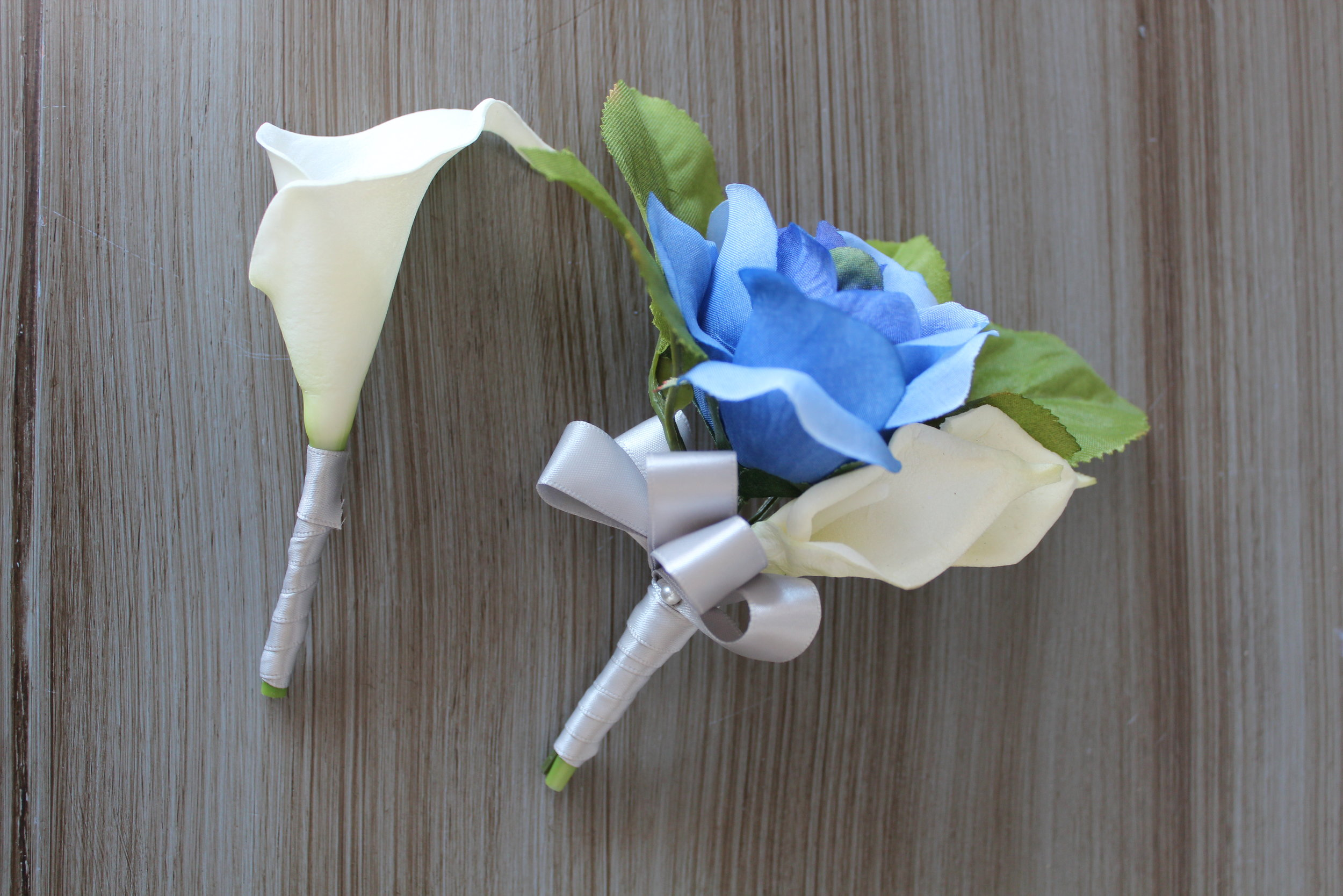 Fathers boutonniere and Mothers Corsage