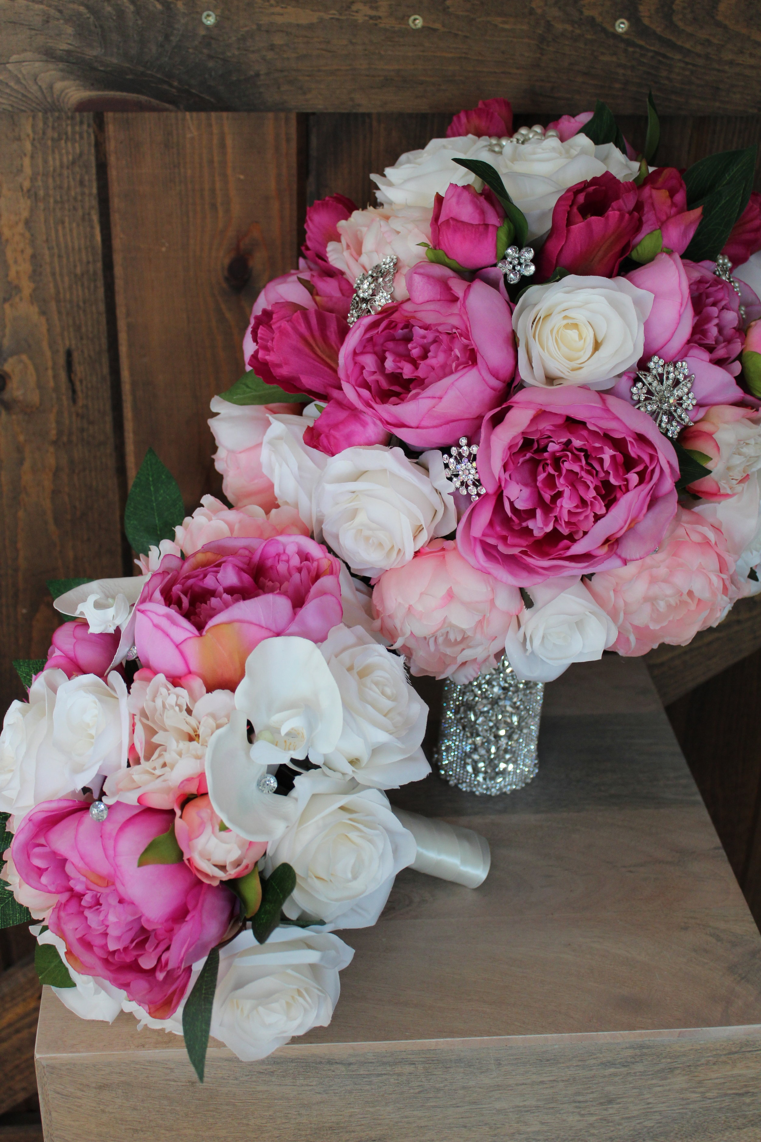 Bridesmaid Bouquet: Ivory Roses, hot pink and blush Peonies, ivory Phalaenopsis Orchids, Greenery.