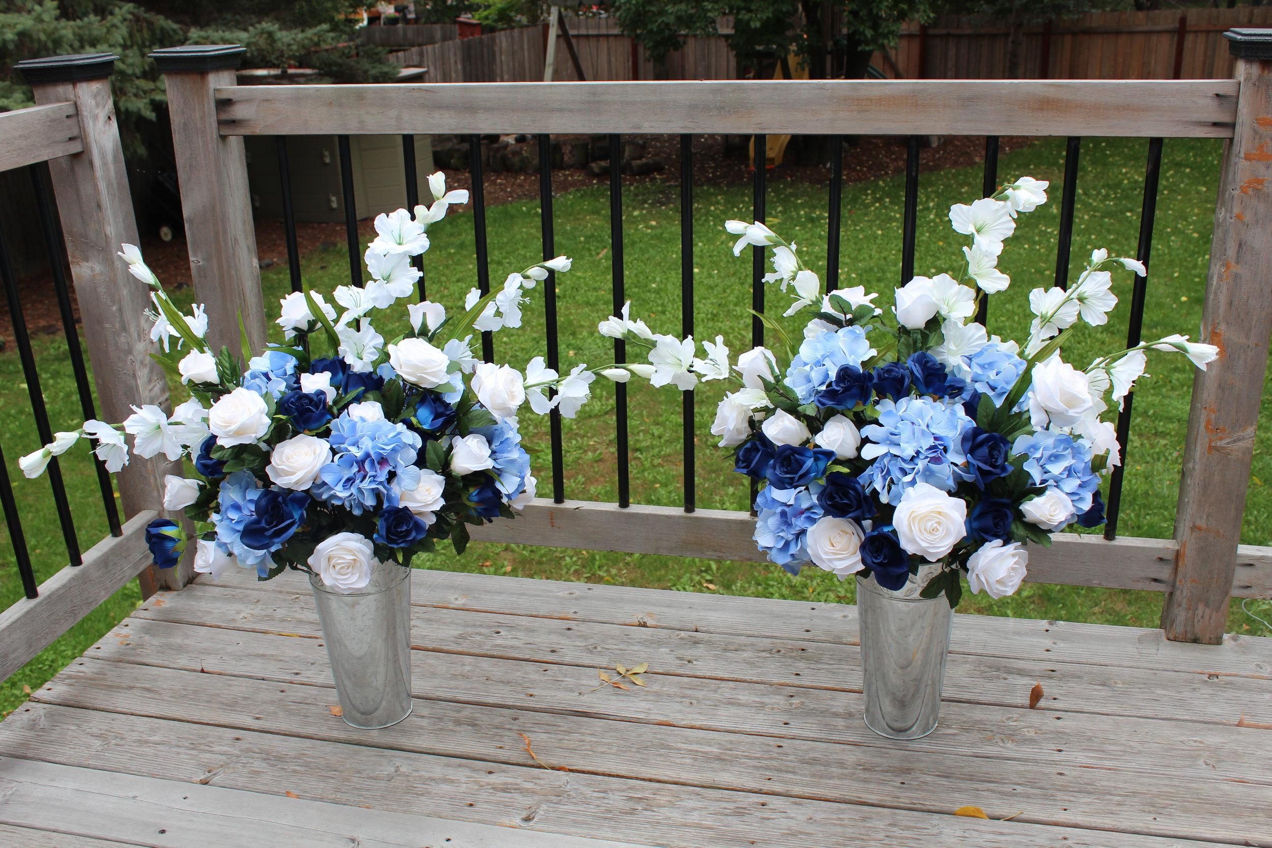 Altar arrangements: blue hydrangea, blue roses, ivory roses, ivory gladiolas
