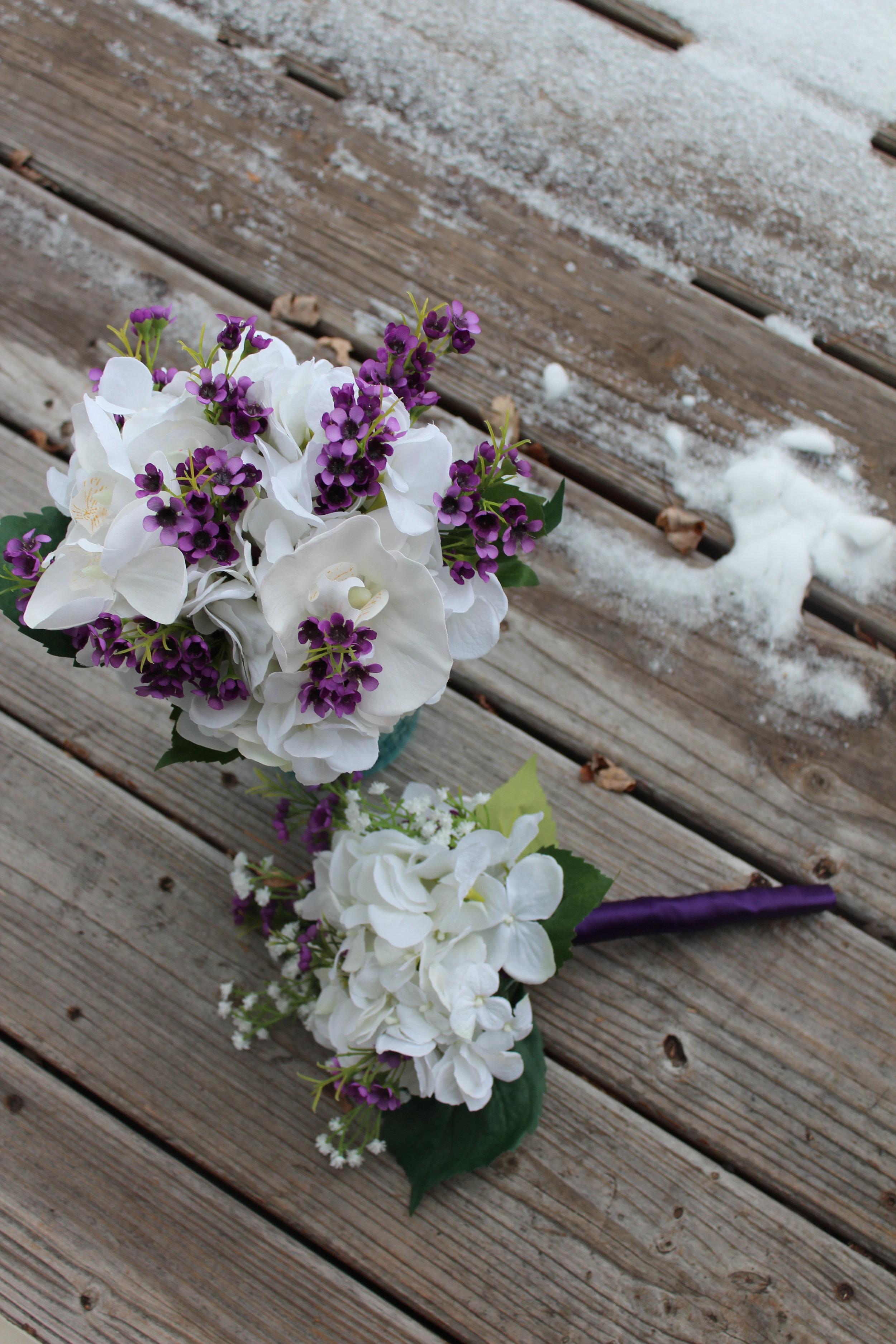 Bridesmaid Bouquet: Hydrangea, Waxflower. Toss Bouquet: Hydrangea, Waxflower, Baby's Breath.