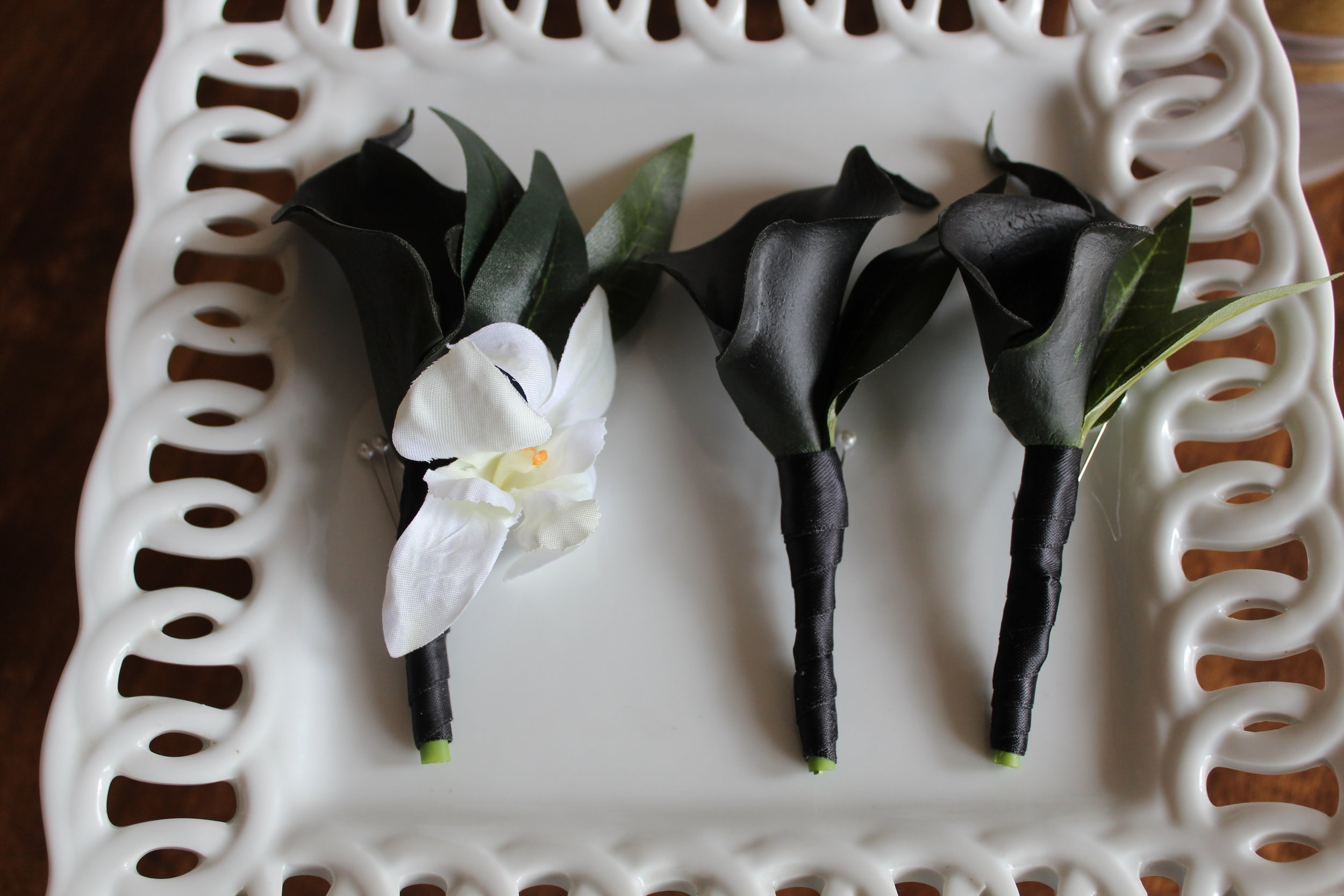 silk-wedding-flowers-boutonnieres-groomsmen-bridal-bouquets.jpg