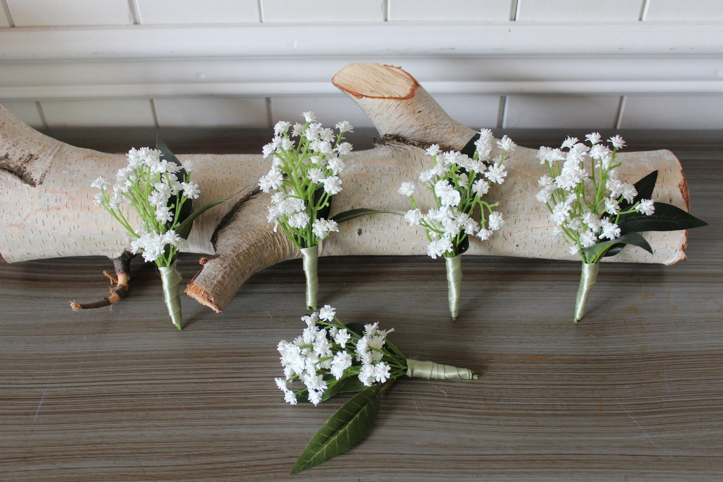 silk-wedding-flowers-groomsmen-boutonnieres-ivory-ranuncuclus.jpg