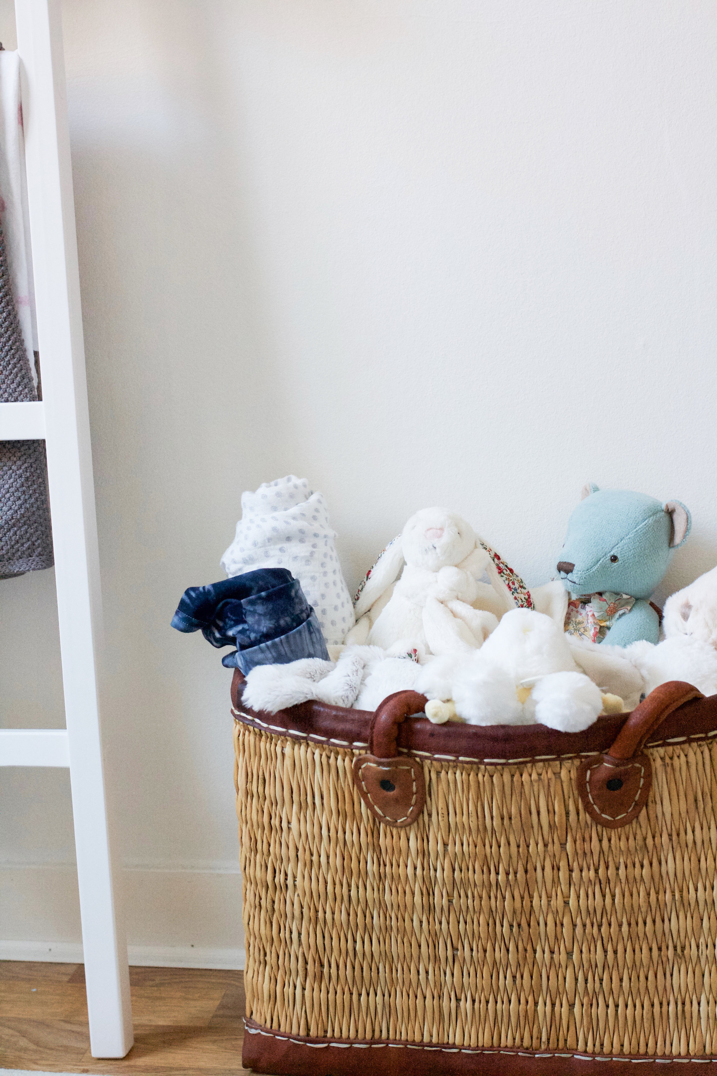 "Just a handful of the many ""gosedjur"" (stuffed animals) we received for Isabella, cozily tucked inside a basket I purchased from the open-air market in Aix-en-Provence, France, where my husband and I met."