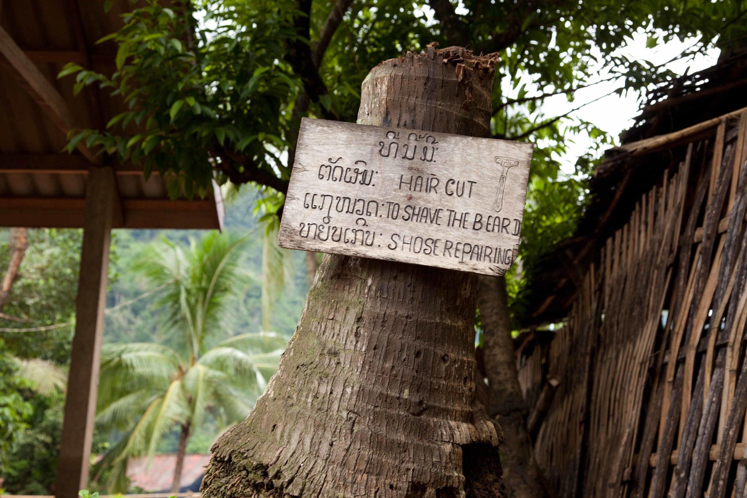 Tourist ads, Muang Ngoi. Credit: Andy Isaacson